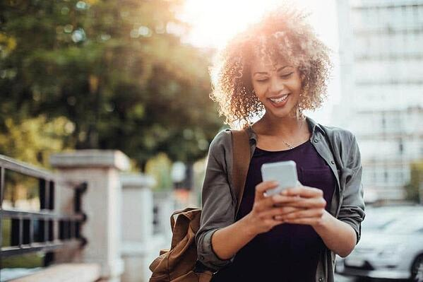 Photo-of-a-woman-using-smart-phone-1200x800
